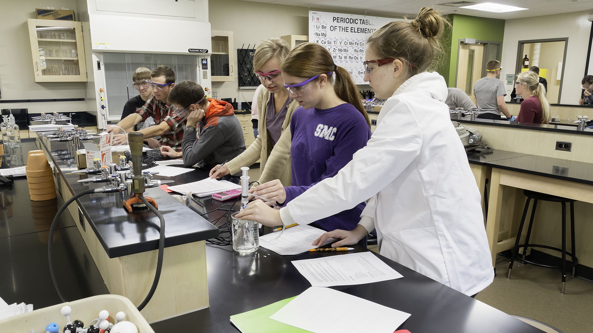 Students performing an experiment in a lab