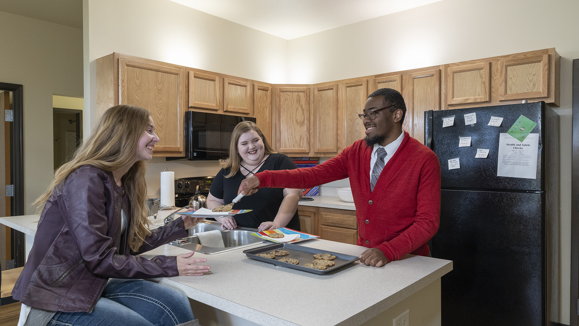 Students making cookies in their dorm room kitchen