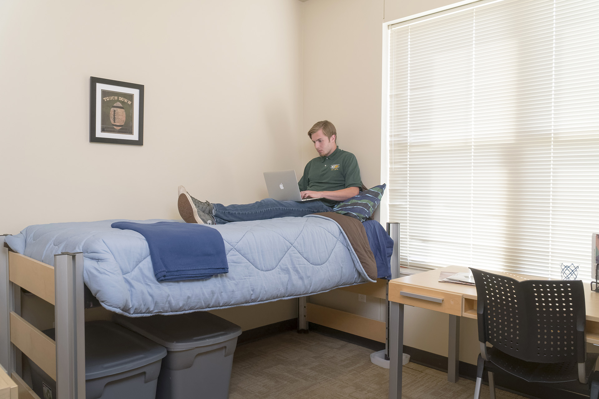 Student reading in their dorm room
