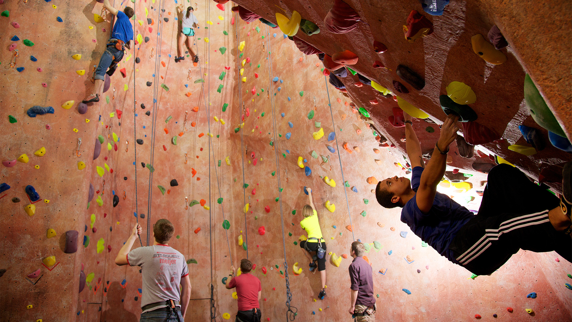 Student climbing in the SAC Rock Climbing room